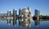 """Science World, Vancouver, BC, Canada reflected in water. Interesting example of a geodesic dome.Check out these related images:"""