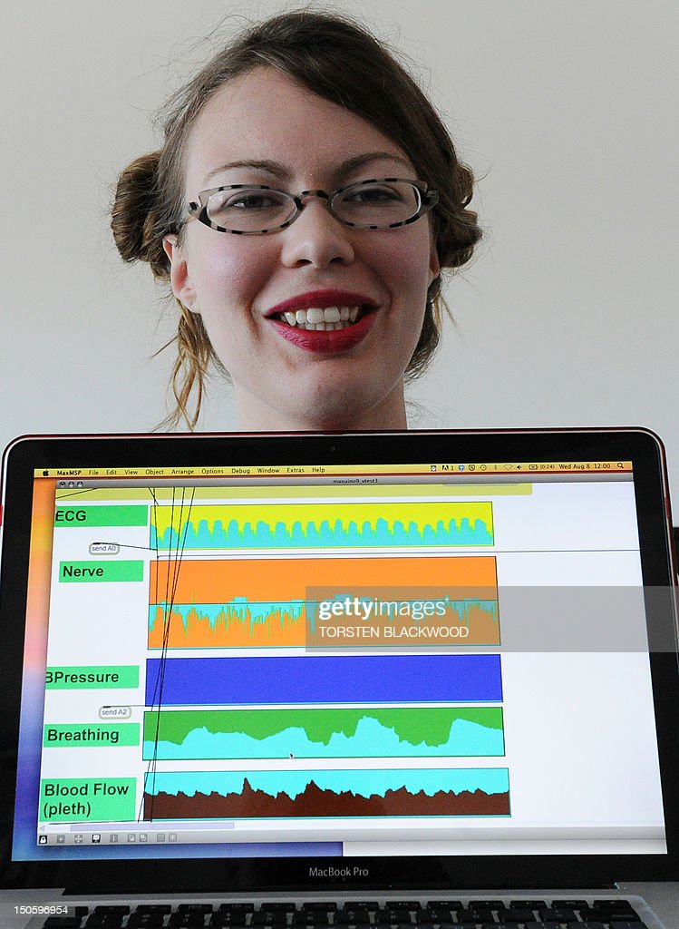 Science-technology-music-Australia-Canada, FEATURE by Amy Coopes In a picture taken on August 8, 2012, audio artist Erin Marie Gee of Canada displays her laptop tracking human nerve impulses and vital organ signals during an experiment at the University of Western Sydney (UWS). Do humans really wear their hearts on their sleeve? An ambitious Australian neuroscience project aiming to translate emotional impulses directly into music is hoping to find out. AFP PHOTO / Torsten BLACKWOOD