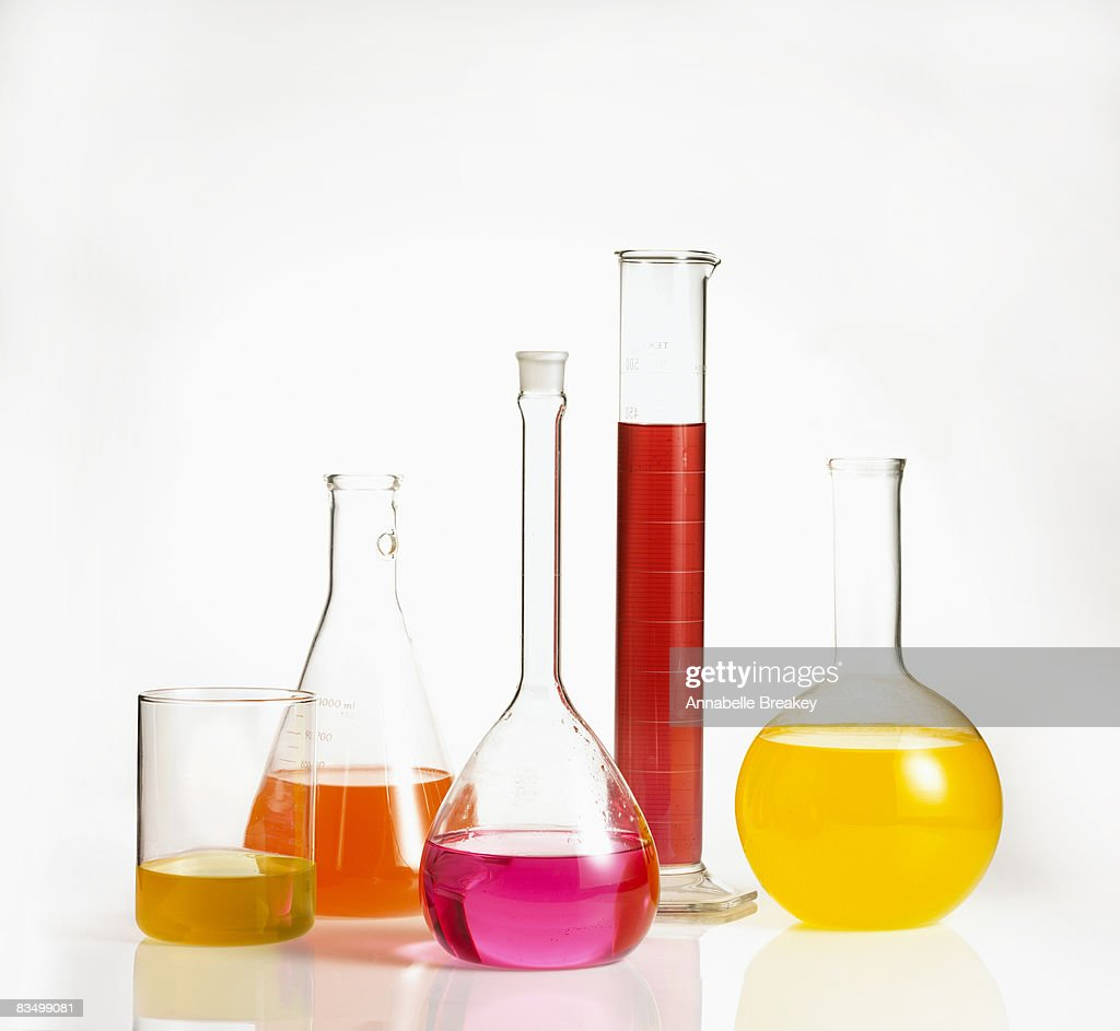 Scientific measuring beakers with colorful liquid : Stock Photo