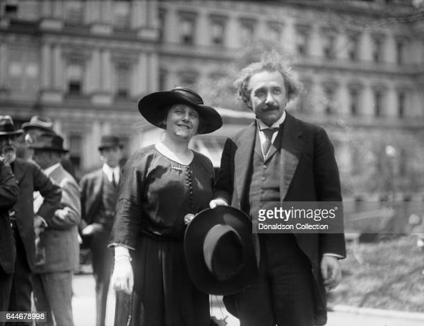 Scientist Albert Einstein and his wife Elsa Einstein pose for a portrait in front of the State War and Navy Building in circa 1927 in Washington DC