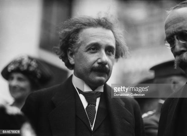 Scientist Albert Einstein poses for a portrait in front of the State War and Navy Building in circa 1927 in Washington DC