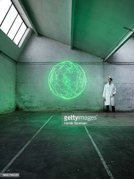 Scientist analyzing a holographic globe