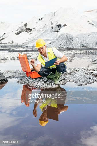 Scientist at industrial site