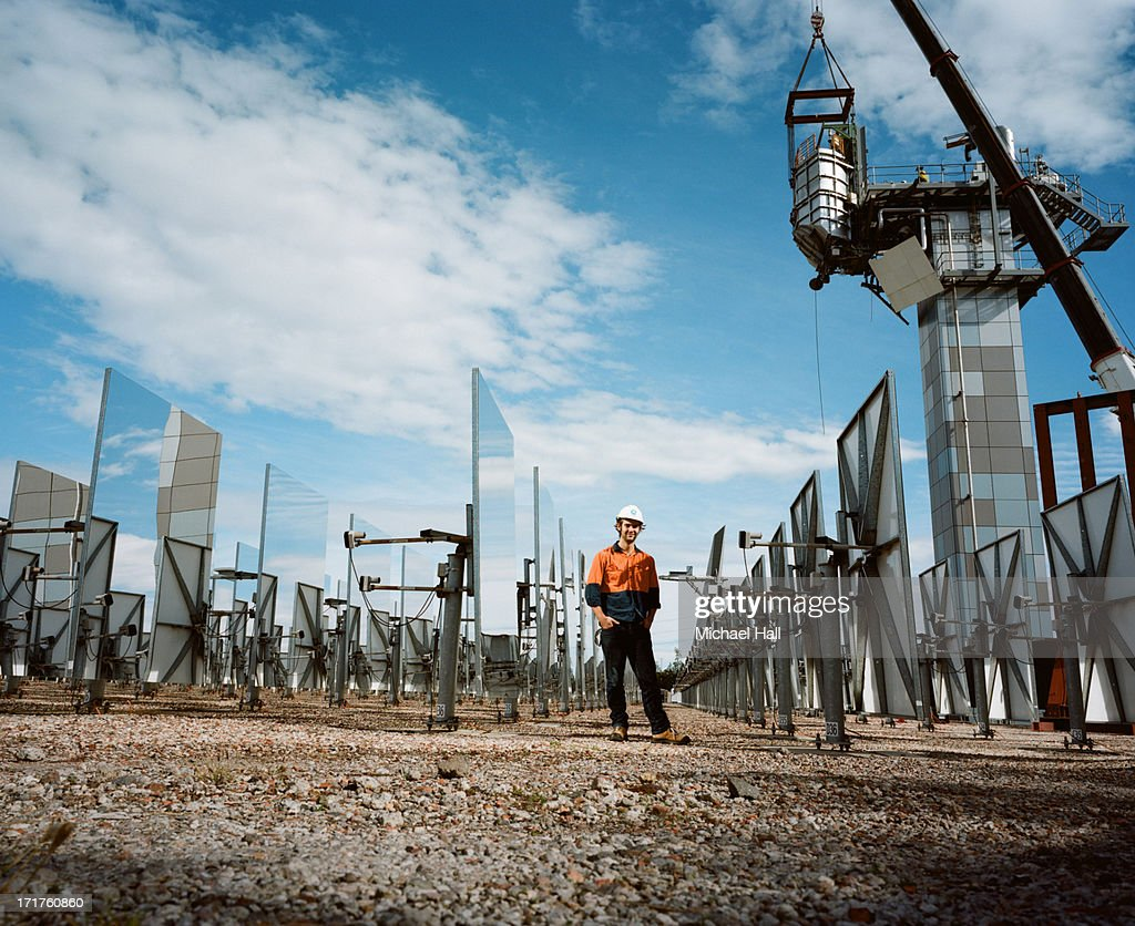 Scientist at solar thermal research facility : Stock Photo