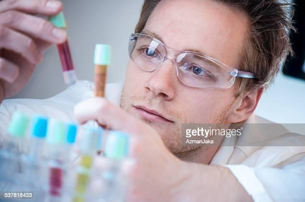 Scientist Comparing Results