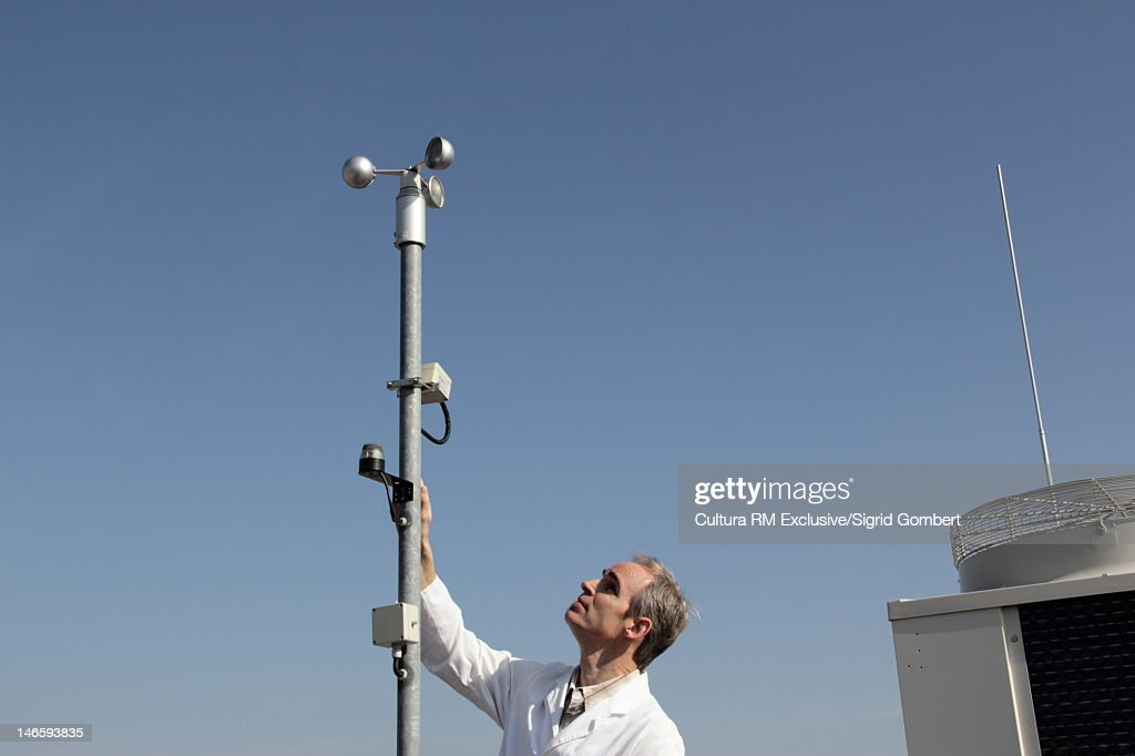 Scientist examining air metereology : Stock Photo