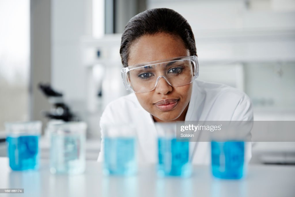 Scientist examining laboratory samples : Stock Photo