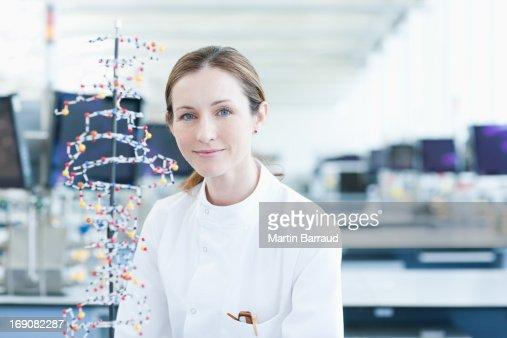 Scientist examining molecular model in lab