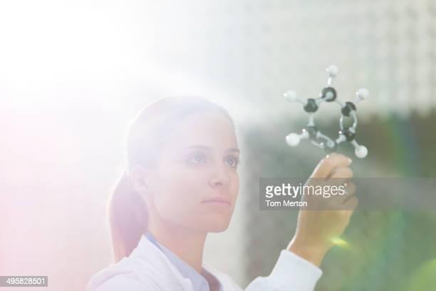 Scientist examining molecule model