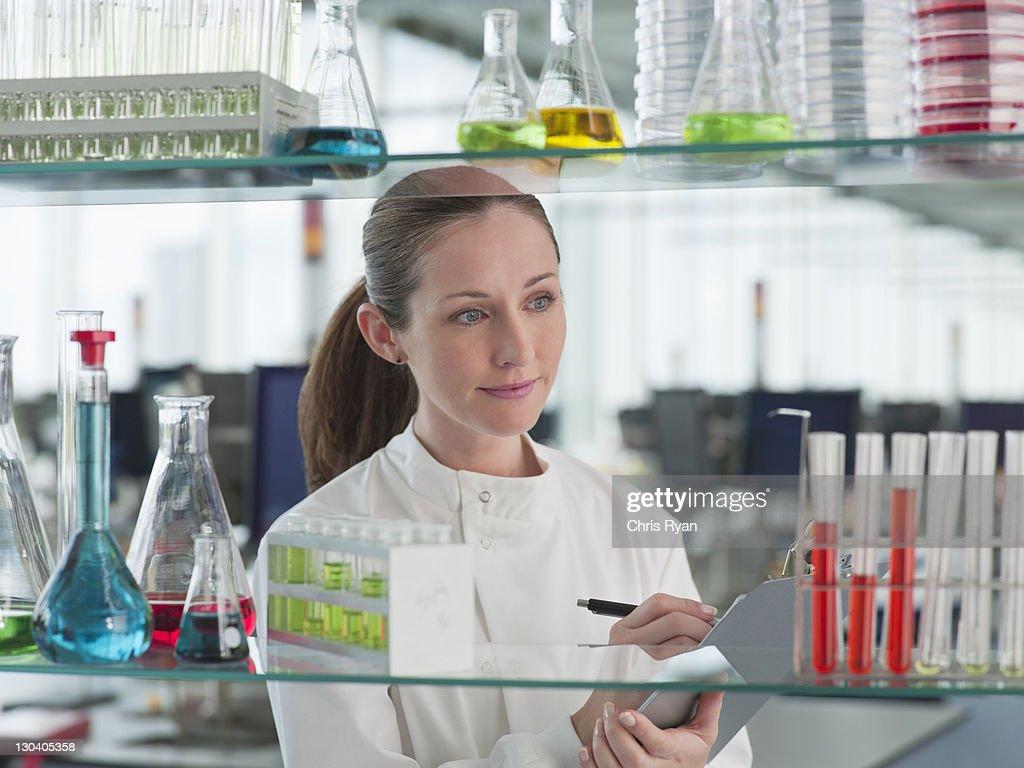 Scientist examining test tubes in lab : Stock Photo