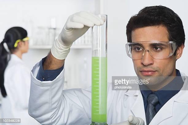 Scientist holding a burette