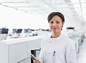 Scientist holding tablet computer in lab