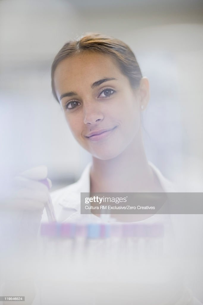 Scientist holding test tube in lab : Stock Photo