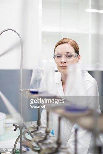 Scientist in lab working with liquids