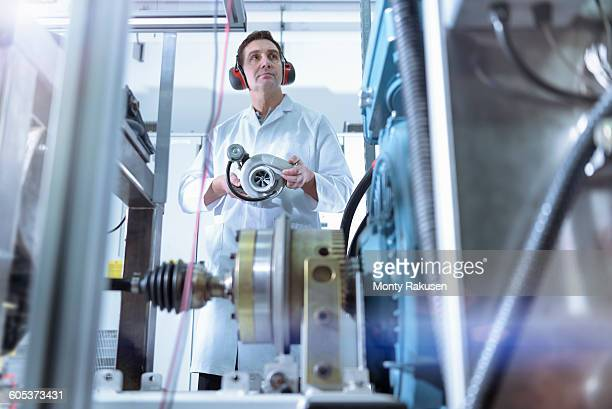 Scientist in turbo charger automotive research laboratory