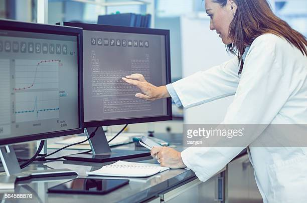 Scientist Interacting With The Computer Via Touch Screen