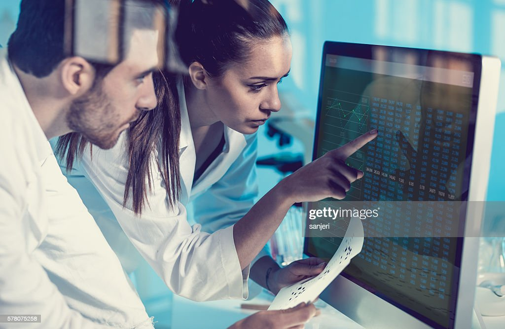 Scientist Interacting With the Computer Via Touch Screen : Stock Photo