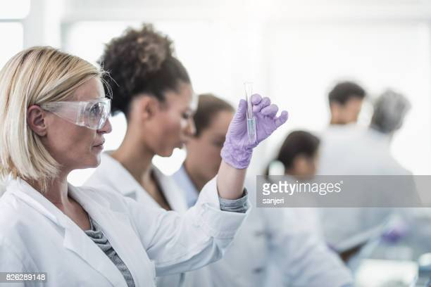 Scientist Looking at Filled Test Tube