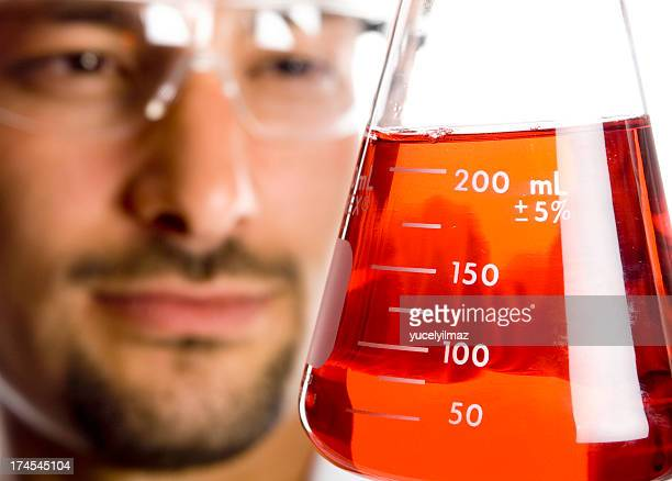 Scientist looking at Red Liquid