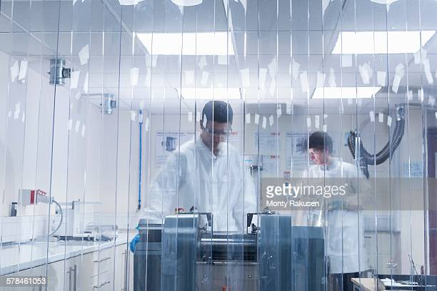 Scientist manufacturing graphene ink in graphene processing factory
