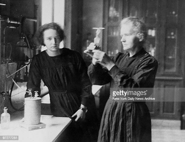 Scientist Marie Curie and daughter Irene working in the radium laboratory in Paris