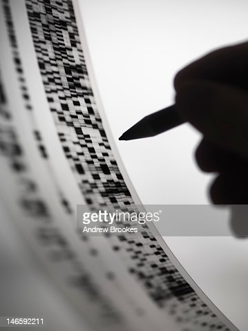 Scientist marking up DNA autoradiogram : Stock Photo