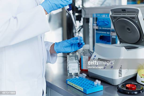 Scientist pipetting samples into eppendorf tubes