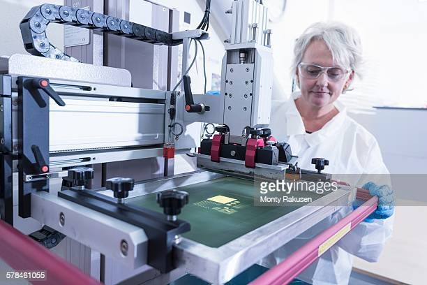 Scientist printing graphene ink test in graphene processing factory
