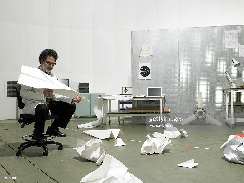 Scientist sat in chair resolving problem