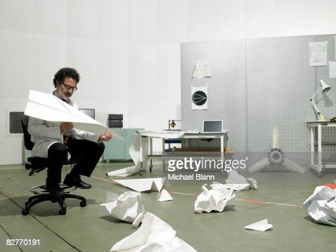 Scientist sat in chair resolving problem : Stock Photo