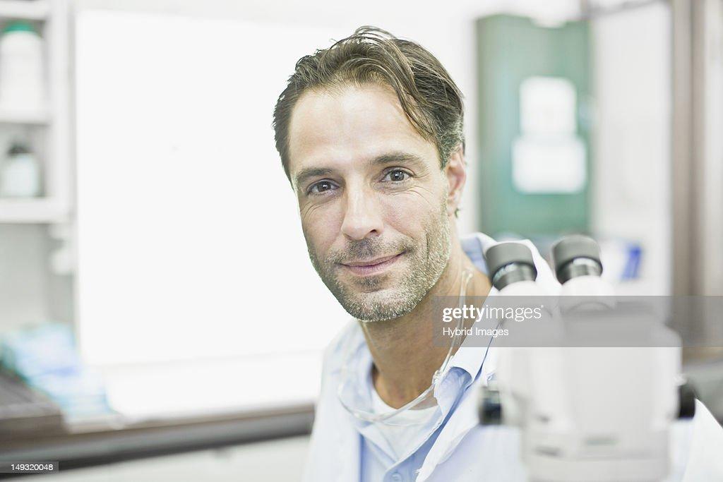 Scientist smiling in lab : Stock Photo