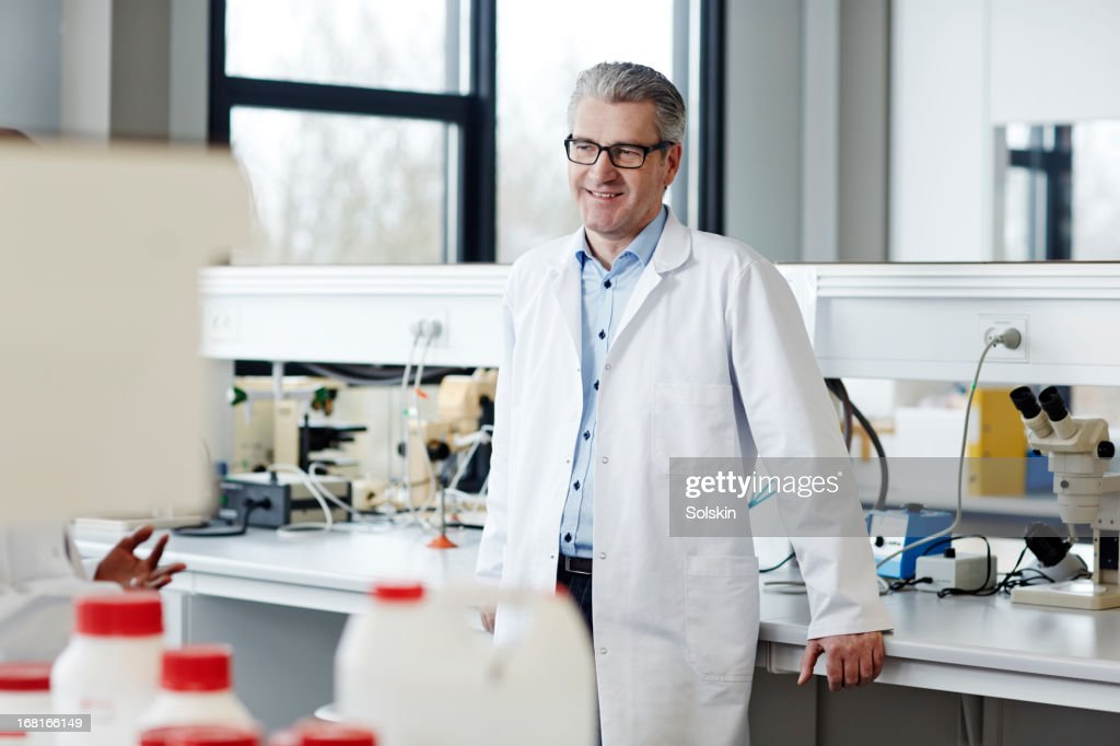 scientist standing in laboratory : Stock Photo