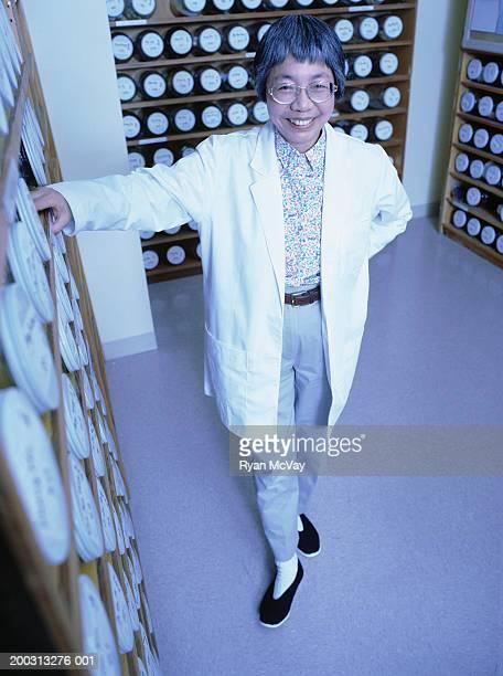 Scientist standing in laboratory storage room, portrait