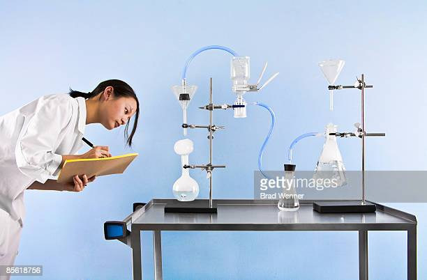 Scientist Takes Notes on Experiment