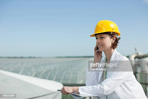 Scientist talking on cell phone outdoors