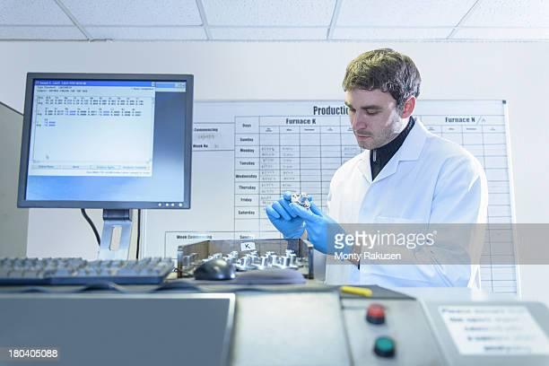 Scientist testing aluminium samples in aluminium foundry