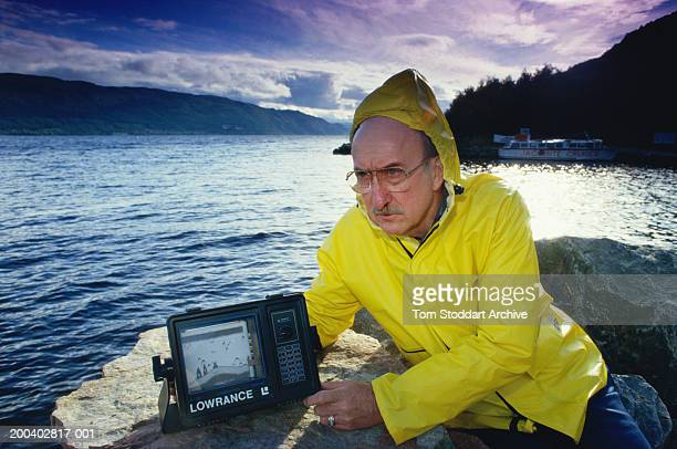 Scientist Thayne Smith Lowrance with a sonar device during one of his many attempts to find the legendary Loch Ness Monster Scotland February 1999