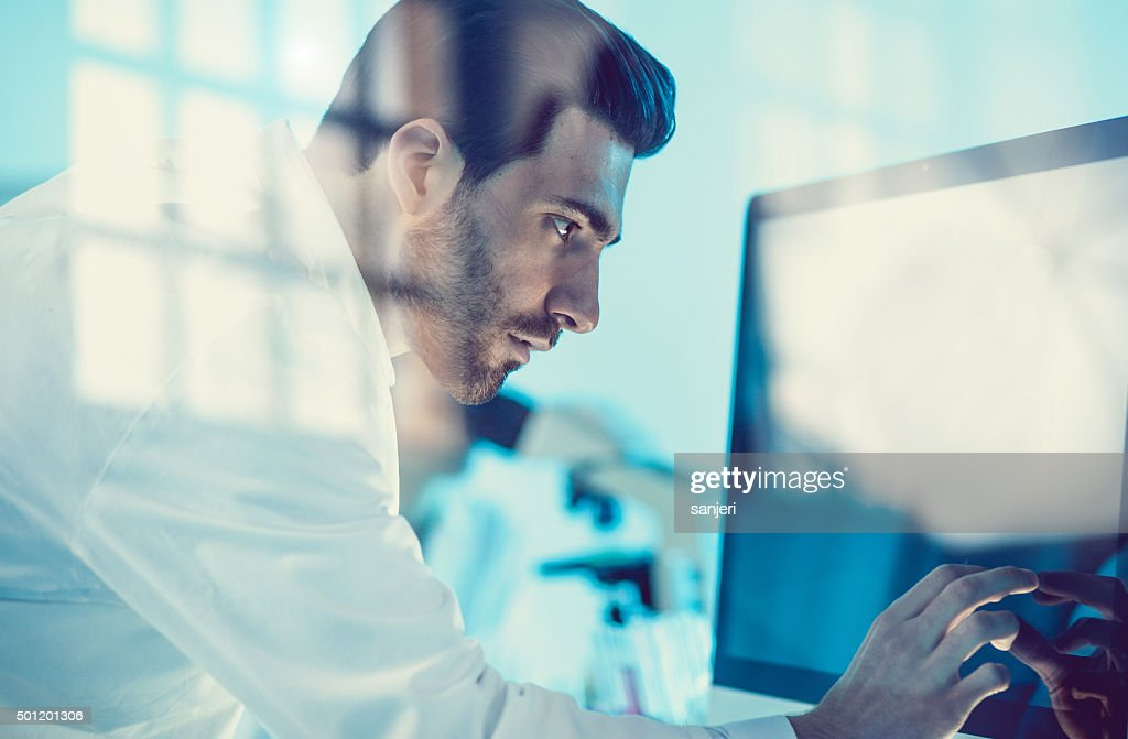 Scientist uses modern technology for its research : Stock Photo