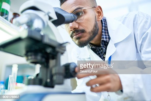 Scientist Using Microscope in Laboratory : Foto de stock