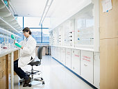 Scientist using pipette in research laboratory