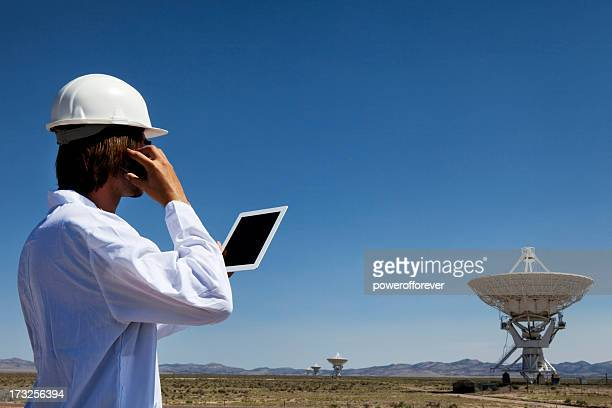 Scientist Using Smart Phone and Tablet