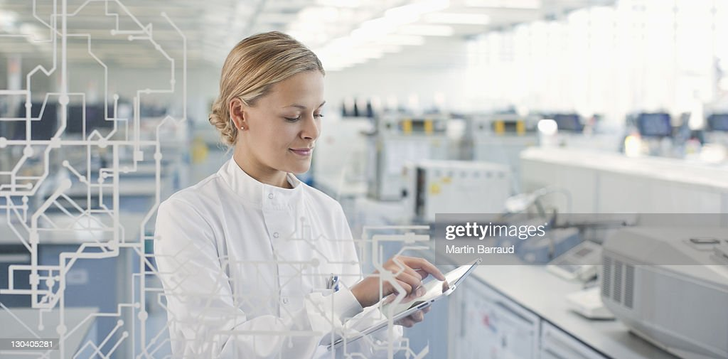 Scientist using touch screen in lab : ストックフォト
