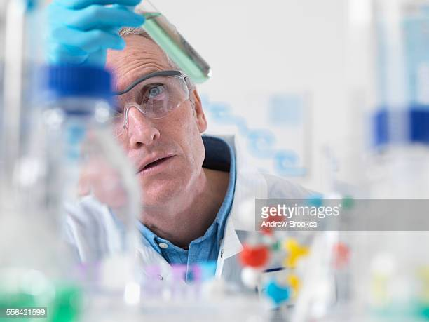Scientist viewing chemical experiment in laboratory