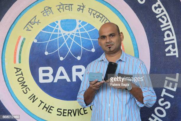 Scientist Vineet Sinha poses with a credit card sized lifesaving electro cardio graphic machine at the Bhabha Atomic Research Centre on March 4 2017...