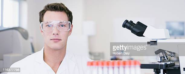 Scientist wearing goggles in laboratory