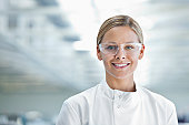 Scientist wearing protective glasses in lab