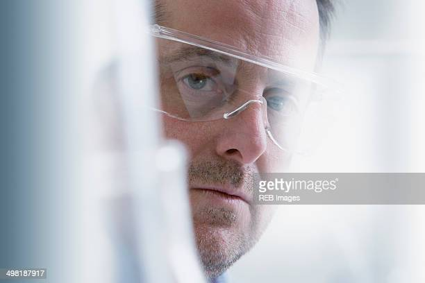 Scientist wearing protective goggles, close-up