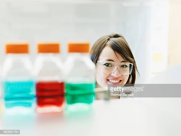 Scientist wearing safety glasses in research lab