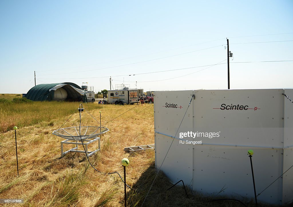 Scientist will start a month study on air pollution using satellites, aircraft, and a balloon, July 14, 2014. The scientist and their equipment are set up on mesa above NREL in Golden.