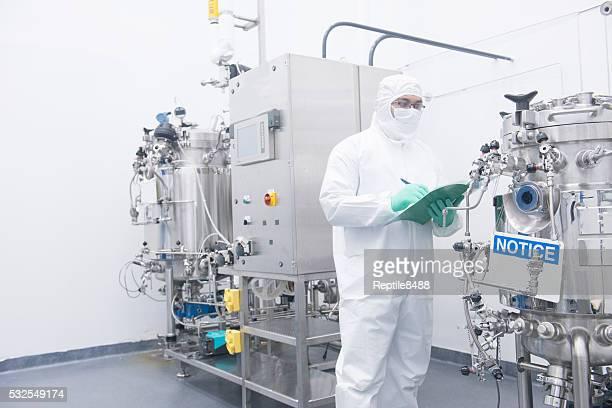scientist with bioreactor
